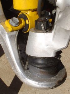 Lower ball joint fastened to steering knuckle on C4 Corvette