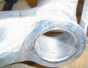 Lower control arm after bushing removed on C4 Corvette