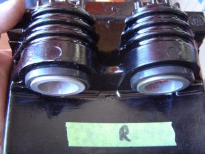 C4 Corvette front caliper pistons and boots assembled