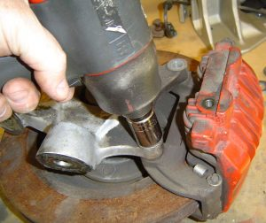 Removal of the C4 front caliper bracket from the knuckle