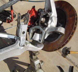 Puller used to remove steering knuckle from lower ball joint C4 Corvette