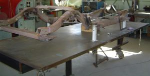 C1 frame in modification jig, 1957 Corvette RestoMod